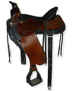 Western Trail Saddle with butterfly skirts, double rigged with flank cinch, Frank Bell pommel, extra padded seat, Paw Print border tooling and a Leatherman holder on the rear jockey.