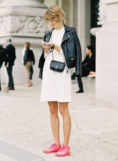 "STREET STYLE : Veronika Heilbrunner from ""mytheresa"" - in white dress with black biker jacket, classic Chanel bag and pink Nike shoes..."