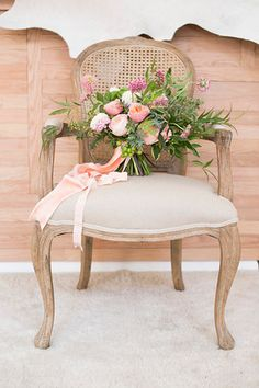 Our Edward Cane Back Arm Chair was the perfect holder for this stunning bouquet! Ready for event rental with Perch Event Decor - perchdecor.com
