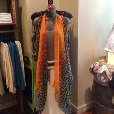 No scarf needs to be JUST a scarf! This beautiful orange and teal patterned Pretty Persuasion scarf makes an amazing vest! #rustichouse #fashion #pdx #shopportland #styleinthepearl @sitacouture @Rosemunde