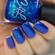 Colors by llarowe Holiday 2016 - Ho, Ho, Ho, It's Santa LaRowe - Purchase the full 8 set CbL Holiday 2016 Collection and receive this fabulous topper polish as a free bonus! This is a sheer bright blue multichrome flakie polish. Layer it over a complementary colour to embellish your manicure. Swatch courtesy of @lakkomlakkom.