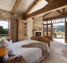 Love this master bedroom.... stone, floor, beams and the open concept windows.  Beautiful