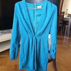 Tobi long sleeve romper Love love love this romper. Tobi deep neck long sleeve romper in color Jade green. In great condition. Zips down back. WILL INCLUDE A FEW STRIPS OF FASHION TAPE FOR FREE. I didn't need to use fashion tape but just made me feel more secure. PRICE IS FIRM Tobi Pants Jumpsuits & Rompers