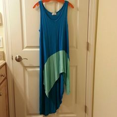 Asymmetrical high - low turquoise/sea foam dress Soft,  comfy Jersey dress with asymmetrical, high - low hem.  Made by Bellino. Not sure of the size but it's probably a M/L. I'm a M or 6/8 and it's pretty blousey and loose on me. Bellino Clothing Dresses Asymmetrical