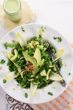 Lean Mean Green… Pea Salad with Creamy cucumber dressing •   Ingredients salad:   1½ cup frozen green peas  1 large English cucumber  1 small endive  ½ cup watercress, stems removed  1 avocado, diced  50g walnuts, coarsly chopped  3-4 cups arugula   • Ingredients for Dressing:   the peels and seeds from the cucumber  ¼ cup 0% fat Greek yogurt  4-5 Brazil nuts, chopped  1 tsp Dijon mustard  1 tsp liquid honey  1 tsp white wine vinegar  ½ tsp salt  ¼ tsp black pepper