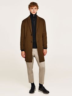Why Your Wardrobe Needs A Half-Zip Sweater #beige #clothing #outerwear #jacket #fashion #brown #gentleman #standing #blazer #khaki