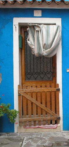 This doorway is in Burano, Italy-I love this, very functional :)