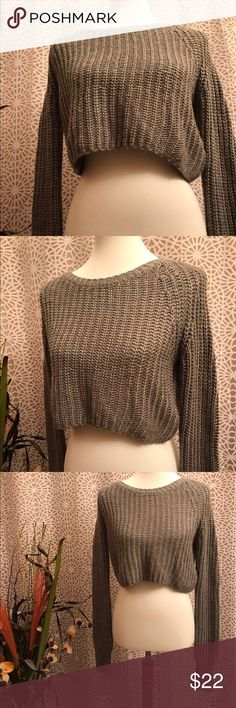 Urban Outfitters Kimchi Blue Grey Cropped Sweater This cute Kimchi Blue grey cropped long sleeve sweater is extremely versatile. 72% acrylic and 28% wool. Kimchi Blue Sweaters Crew & Scoop Necks