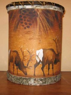 HAND PAINTED BIRCH BARK ELK WASTE BASKET - A beautiful finishing touch to any room. This elk waste basket is hand painted by Diana Le Clair and is made from real birch bark with leather ties. Made in the USA!