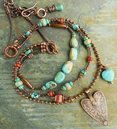 """""""Genuine turquoise, impression jasper, poppy jasper, and magnesite, mixed with burnished copper and cocoa brown leather; heart pendant hand-crafted from raw copper sheet (they're reversible). Copper components sealed in protective lacquer to preserve patina and shine, except for the commercial ball chain which is already sealed."""" (http://artjewelryelements.blogspot.com/2014/02/production-work-or-i-must-be-out-of-my.html)"""