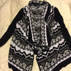 Wet Seal cardigan. This is a cardigan with the longer front from wet seal. It has some balling but still in good condition. Wet Seal Sweaters Cardigans