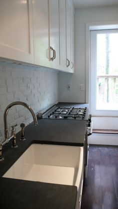 On file for: the slate countertop, farmhouse sink, the running bond backsplash (but forget the painted brick)