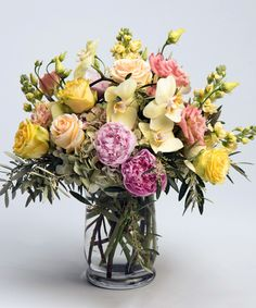 Buttercream A stunning, lush collection of soft pinks, yellows and greens - including peonies, orchids, roses and hydrangea - is designed in a unique glass vase. Mother's Day flowers