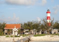 Faro Isla Pérez, station established 1901. The original lighthouse was one of nine cast iron towers given to Mexico by the British government and built by the British firm Chance Brothers. The original wood keeper's house survives in poor condition; there is interest in Progreso in restoring it. The cay, at the south end of the Arrecife Alacrán.