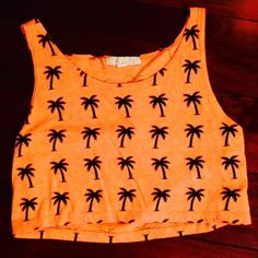 Bright orange crop top Bright orange crop top with black palm trees.  Back looks the same as the front.  Never worn - in perfect condition Forever 21 Tops Crop Tops