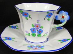 MELBA HANDPAINTED BEADED FLORAL FLOWER HANDLE TEA CUP AND SAUCER