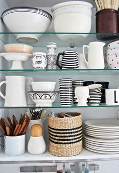 Display of dishes and kitchen utensils, blue and white, shelves, merchandising cabinets