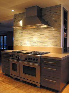 Exclusive Beach Home with Gray Accents: Sleek Modern Kitchen Glass Tile Backsplash Helena House