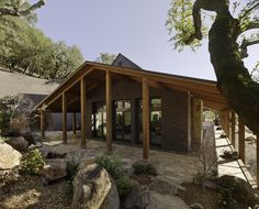A wrap-around porch shelters from the hot summer sun and protects from the winter rains characteristic of Napa Valley.