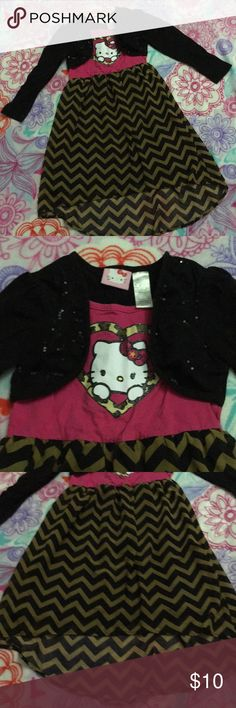 **SOLD** Hello Kitty Chevron Dress 20 Cute dress. All one piece. Pink top with Hello Kitty and animal print heart. Attached black cardigan with black sequins. Skirt is hi low with a chevron print and is fully lined. No holes or stains. Hello Kitty Dresses Casual