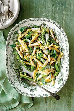 Spring Pea Pasta with Ricotta and Herbs: Our one-pot primavera brings together seasonal favorites: fresh herbs, crunchy sugar snap peas, and sweet peas.