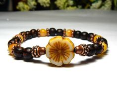Pretty boho bracelet made with 6mm Yellow dyed Jade and Palm Wood complimented a beautiful Czech Flower. So earthy! This looks great with jeans and is perfect to wear everyday. Jade Properties: It is