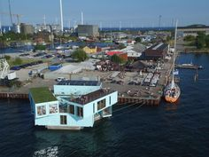 A low-cost alternative to traditional dorms, the Urban Rigger functions as student housing in Copenhagen, Denmark. The development, which has 15 living spaces, is made of recycled shipping containers that float in the city's harbor.