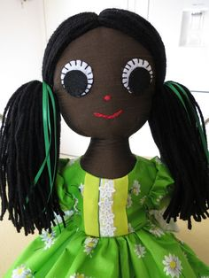 A 21 inch rag doll made of brown slub polyester, stuffed with polyester stuffing, she has black hair tied in bunches. She is wearing a cotton chintz fabric dress in bright lime green, cotton undies trimmed with lace and ribbon. Chintz Fabric, Hair Ties, Green Colors, Black Hair, Dolls, Halloween, Lace, Cotton, Crafts