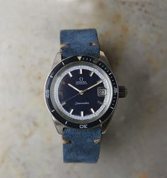 An automatic Seamaster from 1969. Blue dial Ref. 166062. Automatic movement, 19,800 bph (5.5 beats per second), 24 jewels caliber 565, Incabloc shock protection, quickset date, sweep seconds, date at 3 o'clock. Case and crown signed. Seamaster logo on back, 37mm diameter. The piece is in original condition and keeps very good time. We have fully serviced and regulated the movement. Vintage Omega, Vintage Rolex, Vintage Watches, Watches For Men, Men's Watches, 3 O Clock, Omega Speedmaster, Mechanical Watch, Seiko
