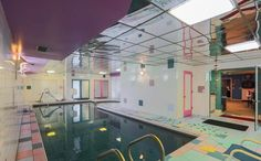 Oh, and because this is the COOLEST house of the they'll also get an indoor pool replete with randomly placed colorful squares and a reflective ceiling. This House Hasn't Changed Since The And It Looks Like Your Childhood Retro Interior Design, Flat Interior, Interior Doors, Teal Walls, Black Walls, Michigan, Time Capsule, Decoration, Interior Decorating
