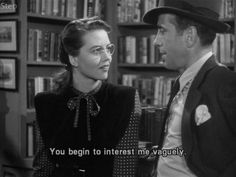 """In a surreal series of scenes from """"The Big Sleep,"""" Detective Philip Marlowe (Humphrey Bogart) conducts an investigation in a town populated exclusively by impossibly sexy women, for no explained reason. It's never explained, nor referred to again in the rest of the movie. Say it with me everybody, BIG LIPPED ALLIGATOR MOMENT!"""