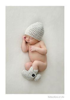 Adorable baby boy in knit hat and booties, simple newborn photo, Niagara Newborn Photographer