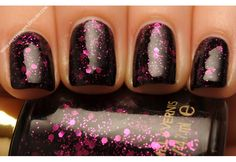 Revlon Nail Polish in Scandalous. This black polish with fuschia glitter and hex glitter is to die for.