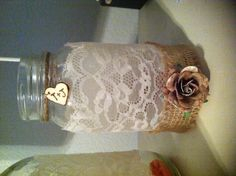 For my wedding, I took mason jars & modge podged lace onto them. I then added burlap and other items- they made great candle holders!