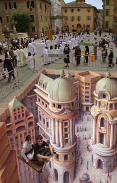 The modern trend in anamorphic sidewalk art owes much to the efforts of Kurt Wenner, a former NASA scientific illustrator who has been crafting meticulous public illusions for the past 30 years. From Rome to London to Las Vegas, his art has dazzled all who walk by it (or on it!).   ~ 'The Flying Carpet' by Kurt Wenner