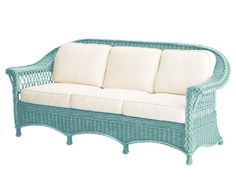 """""""The wicker weave is gorgeous, and I like the thick braid running along the back,"""" says Amanda Nisbet of the 85""""-long sofa. Like most furniture in rattan, this should sit in a covered area, such as a veranda, she advises. """"Or you could use it in the living room of a beach house,"""" she adds. """"It's a great workhorse piece, with nice, comfortable cushions."""" $4,376; palecek.com   - ELLEDecor.com"""