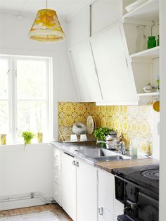 Love the white with pops of mustard, and the angle of the cabinet