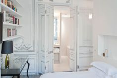 books and a white bedroom - it can't get much better than this.