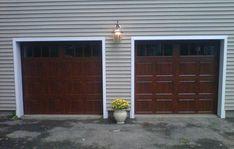 Beautiful ideal door garage doors for Clopay gallery ultra grain walnut
