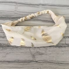 HP Gold Feather Cream Headband!! Headbands are the latest trend and are sure to go with a variety of outfits and hairstyles. This Gold Feather cream headband has never been worn and is in great condition.. Accessories Hair Accessories