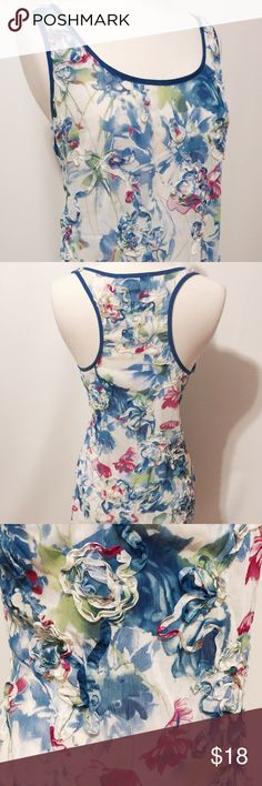 "White & Royal Printed Floral Chiffon Racerback Precious! Crinkle chiffon print with self ribbon flowers throughout (photo 3). Tunic length, free fit, neckline and armhole framed in solid Royal blue. 100% poly Fry Clean 38"" bust 27"" overall length Boutique Tops Tank Tops"