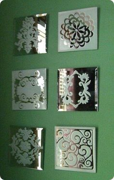 Spray paint mirrored tiles with frosted paint found at craft stores using stencils.