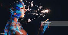 Women Portrait with UV Make-Up holding sparkler in Neon Light
