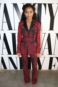 Yara Shahidi was suited up at the 2016 Vanity Fair Social Club For Emmy Weekend in a Philipp Plein Red and Black Printed Single Button Blazer and $885 Flared Trousers: Her red trousers boast an allov