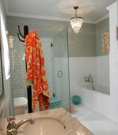 hex tile. white painted wood wainscot and tub apron, my daughter's MBath remodel. See more at atticmag.com