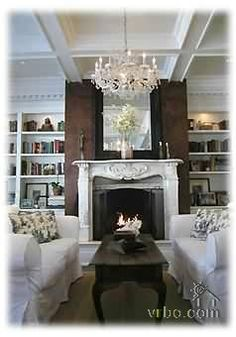 East Hampton home. oh wow. the ceiling, the chandelier, the book cases.