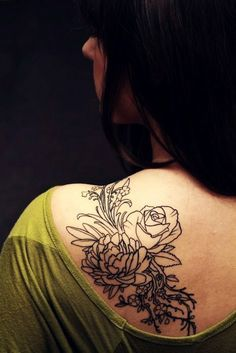 girly flower tattoos on shoulder and arm - I'd use the kids' birth months