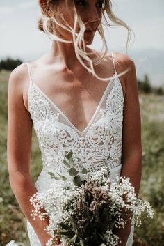 Made With Love 'Sasha' size 4 used wedding dress front view close up on bride