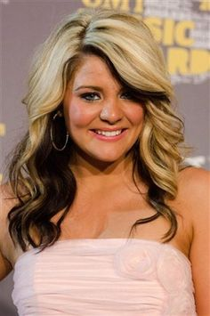blonde with dark underneath hairstyles | Country music's hottest hairstyles (AP File Photo)