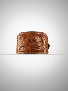 Hand-tooled by Mexican artisans, our leather cuff is defined by intricate florals with exquisite detail for a bold look.